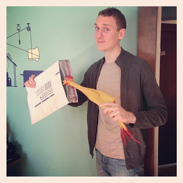 Kevin Barry from Automatic Improv stuffs a rubber chicken into an envelope